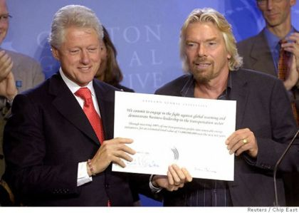 Bill Clinton and Richard Branson holding the climate change pledge card in 2006